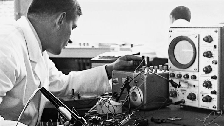 Development engineers testing a circuit for an electronic timer