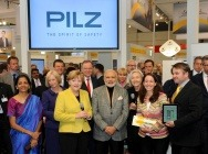 During their tour of the exhibition at the Hannover Messe, Chancellor Angela Merkel (3rd from left) and Narendra Damodardas Modi, Prime Minister of the Republic of India (centre), visited the automation company Pilz. Both were welcomed by Renate Pilz, Chair of the Board (3rd from right), daughter Susanne Kunschert (2nd from right) and son Thomas Pilz (right), both Managing Partners in the family business.