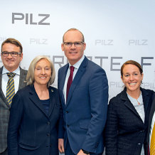 (LtoR) Susan O'Connell (Vice President of Software Development), Thomas Pilz (Managing Partner), Renate Pilz (Retired President), Simon Coveney (An Tanaiste and Irish Minister for Foreign Affairs), Susanne Kunschert (Managing Partner) and John McAuliffe (Managing Director Pilz Ireland)